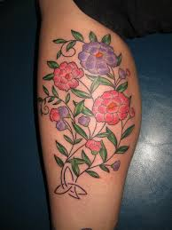 beautiful polynesian flower tattoo on hip photos pictures and