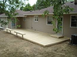 nice simple deck with half covered in pergola plus box seat