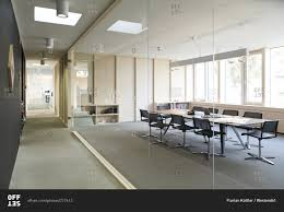 Modern Conference Room Design by Corridor And Modern Conference Room Separated By Glass Pane Stock