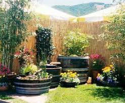 Half Barrel Planters by Garden Design Garden Design With Half Wine Barrels Planting With