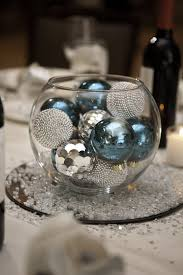 picture of a glass bowl filled with turquoise and silver ornaments