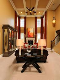 photos hgtv two story transitional living room with orange accents