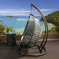 double seater hanging pod chair bare outdoors