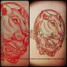 red lioness head in frame with banner tattoo design lioness