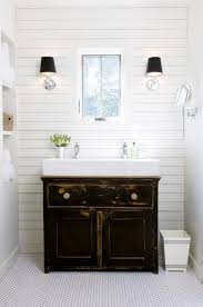 small white trough sink with classic vanity cabinet for