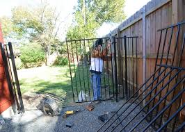 Front Yard Metal Fences - raising up the new fence and gates leonhouse