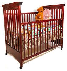 dark cherry wooden crib photograph hardwood crib photo