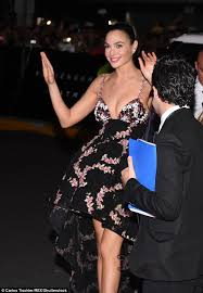 dress gal gal gadot flashes cleavage and legs in low cut floral print dress