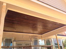 our patio ceiling tongue groove wood with a dark stain love it