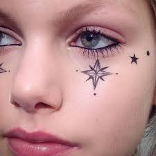 eyeliner tattoo violent eyes drawing stars on your face with eyeliner is a cool fashion week trend