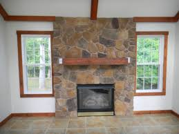 new stone around fireplace on interior with whats over the hill