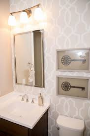 top 25 best small bathroom wallpaper ideas on pinterest half neutral graphic wallpaper takes this small bathroom from basic to chic