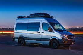 lifted mercedes van aluminess roof rack and rear bumper on mercedes sprinter van