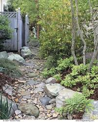 Small Shrubs For Front Yard - dry stream does double duty fine gardening