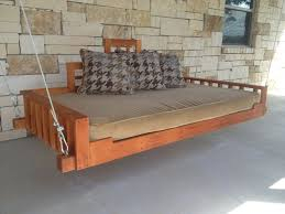 hand made outdoor patio swing bed or hanging day bed by industrial