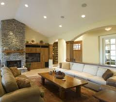 Bedroom Ideas With Brown Carpet Rustic Stone Wall And Wide Fireplace In Comfortable Living Room