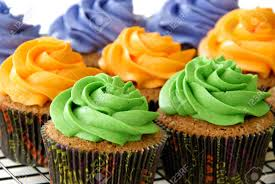 colorful cupcakes in halloween cupcake liners stock photo
