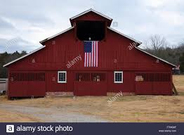 red barn and us flag outside of franklin tennessee a suburb
