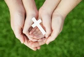 holding a cross oxford catholic chaplaincy