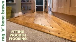 laying wooden flooring in a kitchen