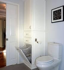 tall bathroom storage cabinet with laundry bin interior