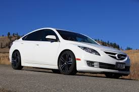 white mitsubishi lancer with black rims will this wheel fit my car the right wheel and tire package kal