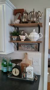 my husband helped me make this open shelving from reclaimed barnwood