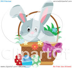 clipart of a happy gray easter bunny rabbit in a basket of eggs
