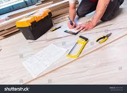 Laminate Flooring Construction Man Laying Laminate Flooring Construction Concept Stock Photo