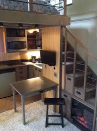 architecture corner kitchen under bedrrom with bedding and