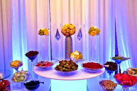 food tables at wedding reception incredible indian wedding in bright yellow by harvard photography