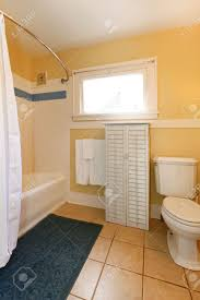 Rugs For Bathroom Floor by Small Bathroom With Tile Floor Yellow Walls Navy Rug And White