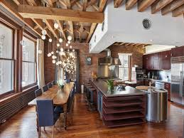 brick wall apartment open plan apartment with exposed wood beams and iron columns