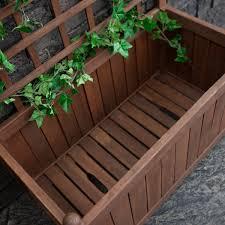 wood planter box on wheels with grid style trellis