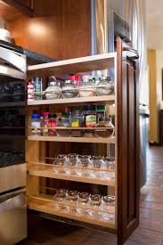 modern kitchen cabinets with 4 tiers light walnut wood kitchen and transparent glass canisters modern kitchen cabinets with 4 tiers light walnut wood kitchen under cabinet pull out spice rack