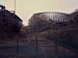 black fox exploring an abandoned theme park nara dreamland