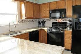 gray kitchen cabinets with black appliances changing cabinet colors maintaining black appliances