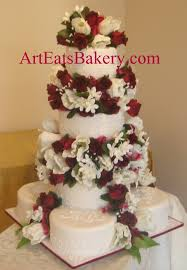 traditional white fondant four tier wedding cake with lace and