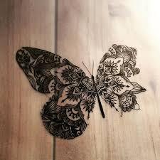 original black line butterfly with folk ornament tattoo design