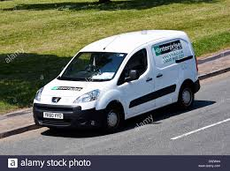 peugeot car hire white peugeot van enterprise rent a car parked on the roadside
