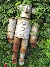 Garden Art Projects How To Make A Tin Can Man Worth The Whisk