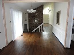 flooring home improvement project using dark wood laminate