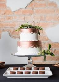 wedding cake greenery picture of white and copper brushstroke wedding cake topped with
