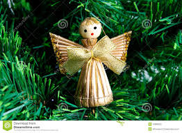 christmas angel made from straw on christmas tree stock photo