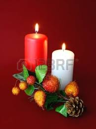 two candles with white and gold ornament stock photo