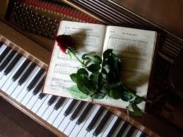 quotes about music on piano file rose on music book on piano jpg wikimedia commons
