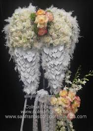 floral arrangements for funeral angel wings floral funeral tribute