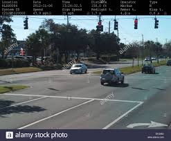 red light camera ticket florida gulf breeze police department traffic camera photographing a silver