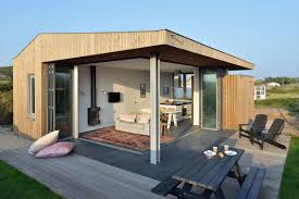 compact houses using corner folding glass doors makes this compact design a real