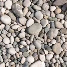 how to prevent weeds from growing through rocks landscaping